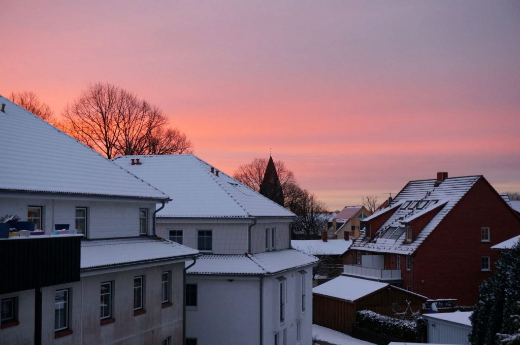 Blick vom Balkon in den Sonnenuntergang